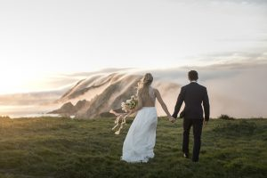 Destination Wedding Locations fog over cliffs