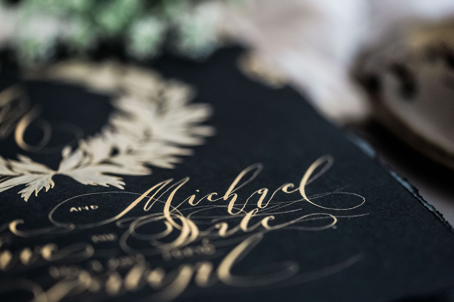 Gold calligraphy flourishes for wedding invitations