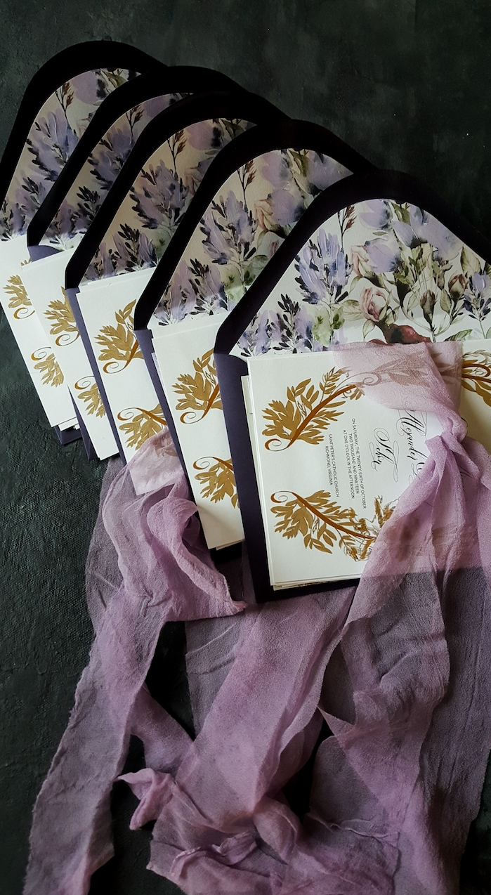 Hand painted wedding stationery with purple white and gold