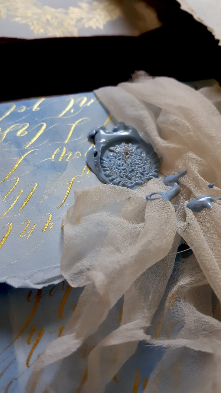 Italian Themed Wedding Invitations - envelope with gold calligraphy and blue wax seal