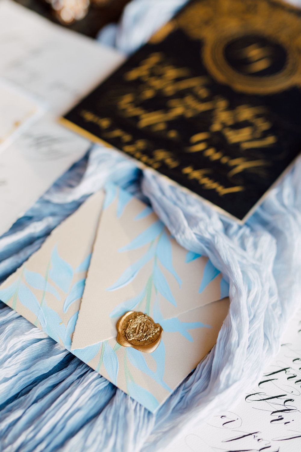 London Wedding Invitations with hand made and hand painted blue envelope and gold wax seal.