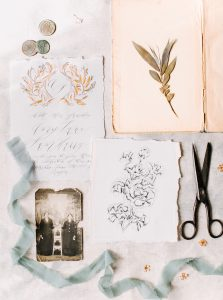Custom wedding invitation with a gold crest