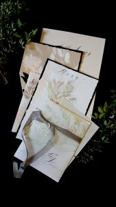 Watercolour Wedding Invitations all placed in a pile