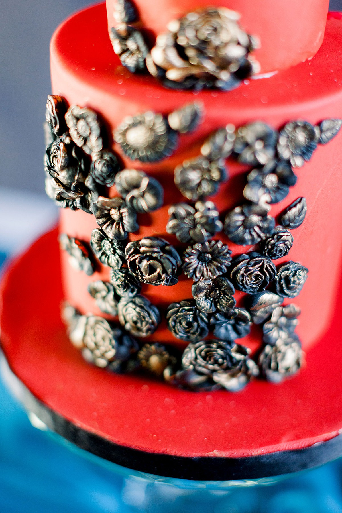 Wedding cake with red black and gold details