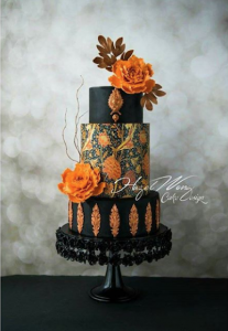 luxury wedding cake designers black and orange cake with baroque details