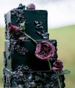 luxury wedding cake designers black cake with purple roses