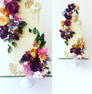 luxury wedding cake designers bright flowers