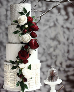 luxury wedding cake designers bright flowers on a patterned background