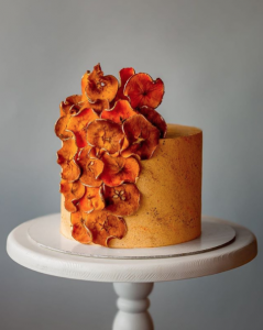 luxury wedding cake designers bright orange and deep red accents