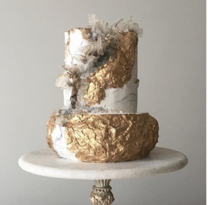 luxury wedding cake designers gold texture with a rock like surface