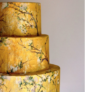 luxury wedding cake designers rich yellow and hand painted white branches