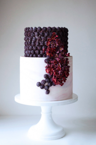 luxury wedding cake designers small dark red flowers and berries