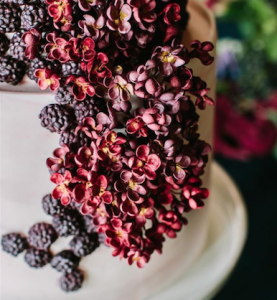 luxury wedding cake designers small red blossoms with purple sugar raspberries
