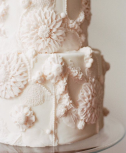 luxury wedding cake designers softly shaped large cream flowers