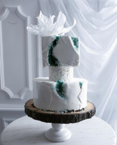 luxury wedding cake designers white and green rocks