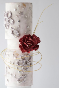 luxury wedding cake designers white tall slim cake with large red flowers and wire