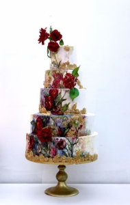 luxury wedding cake designers with gold and deep red flowers