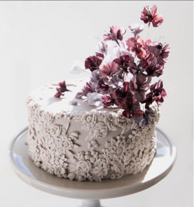 luxury wedding cake designers with small red flowers