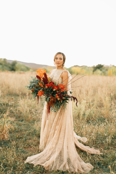 Thankful For Love bride with gold dress with large red bouquet