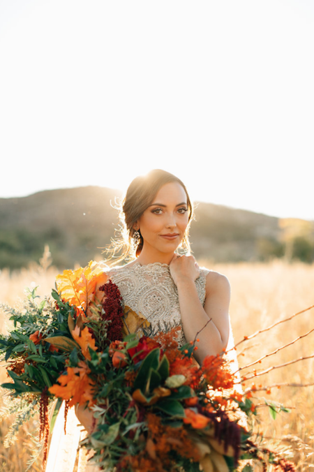 Thankful for Love Autumn inspired style shoot bride holding flowers with hand on shoulder