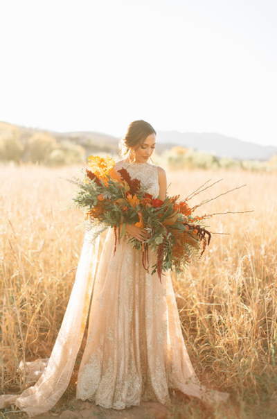 Thankful for Love Autumn inspired style shoot bride standing with bouquet