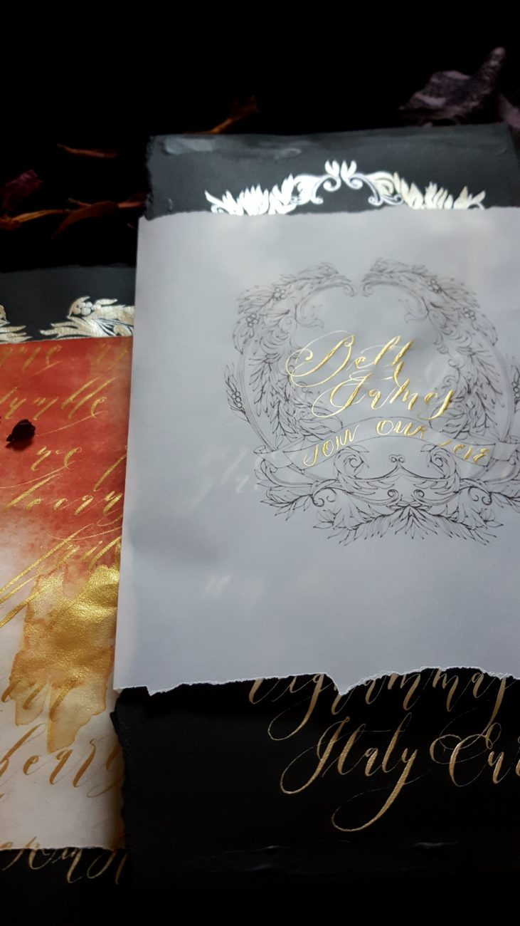 Hand Painted Wedding Stationery - Baroque Splendour black invitation with vellum wrap and gold calligraphy