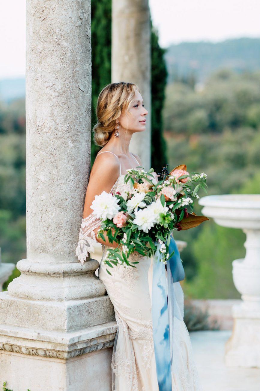 French Wedding Inspiration Bride with bouquet under gazebo close up