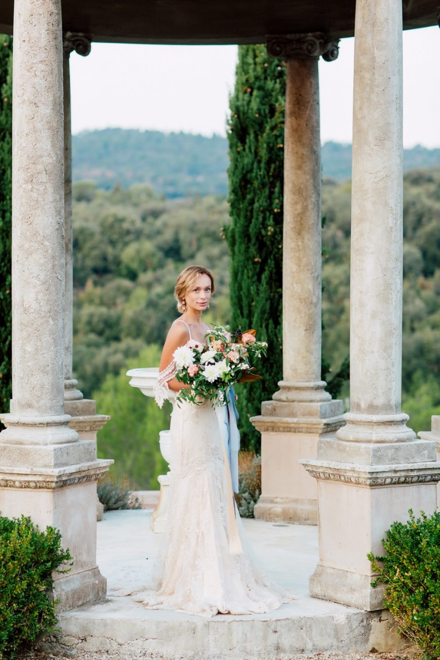 French Wedding Inspiration Bride with bouquet under gazzebo