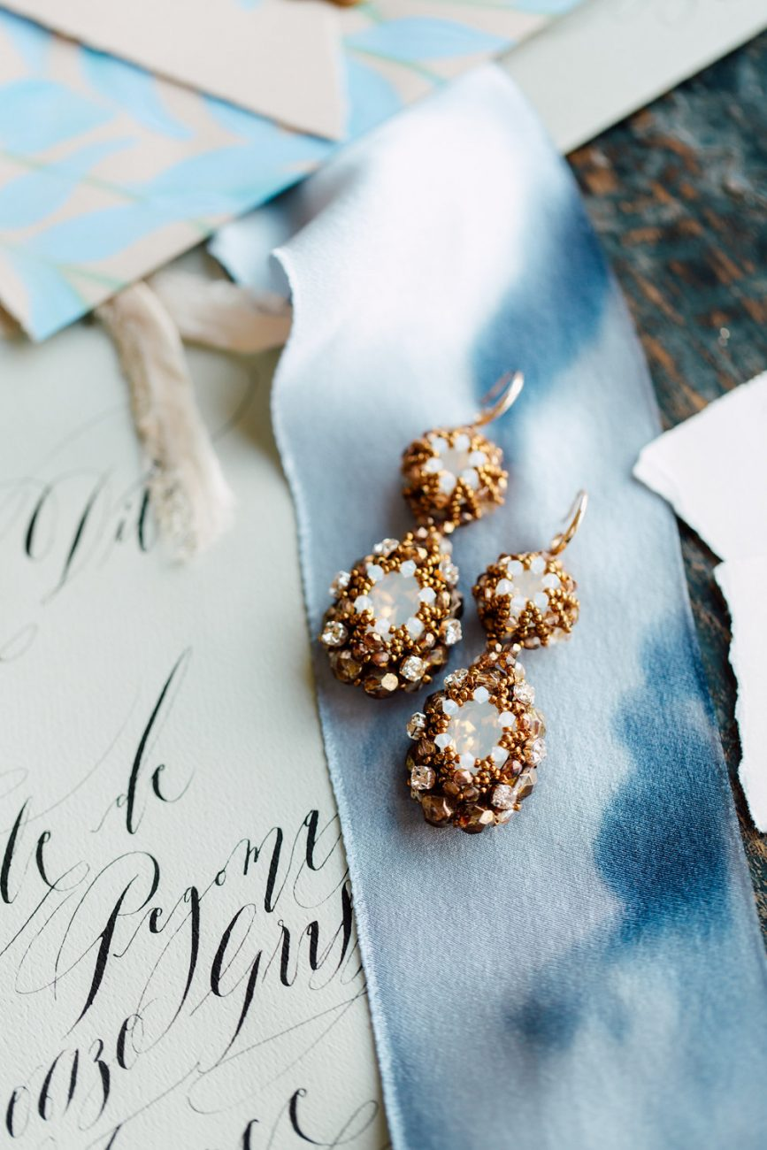 French Wedding Inspiration black calligraphy with gold earrings