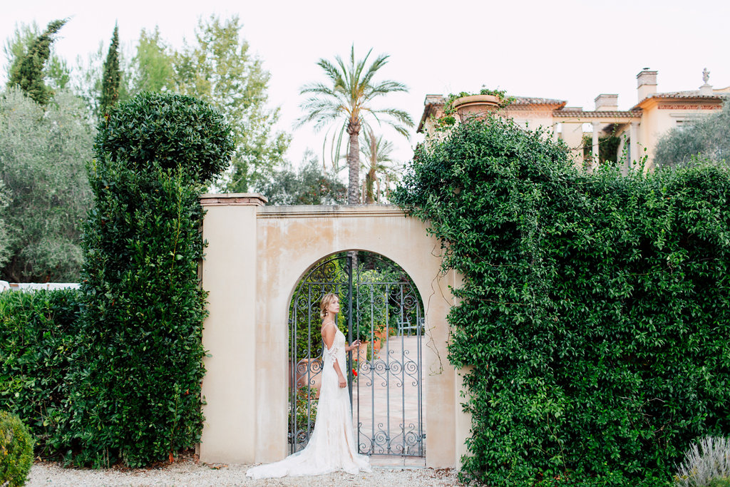 French Wedding Inspiration bride by gates