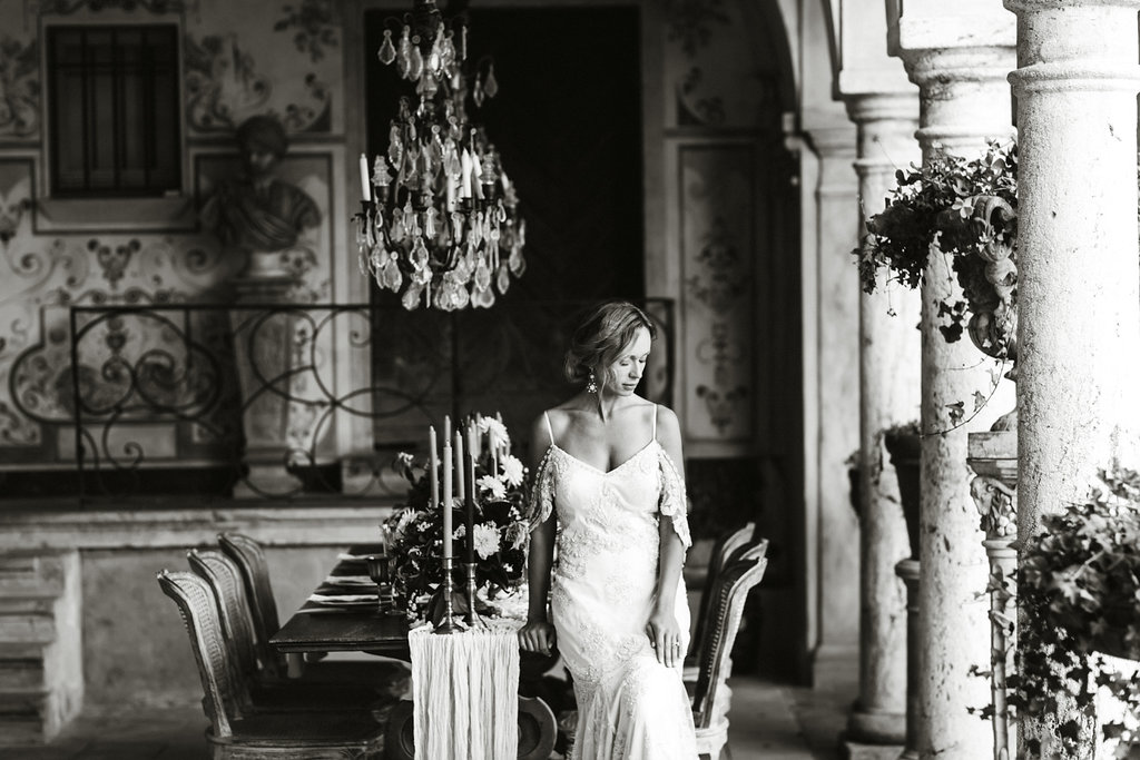 French Wedding Inspiration table setting with flowers and bride leaning on table