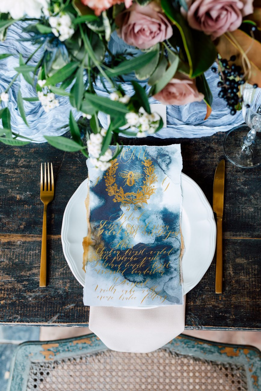 French Wedding Inspiration table setting with hand painted menu in gold