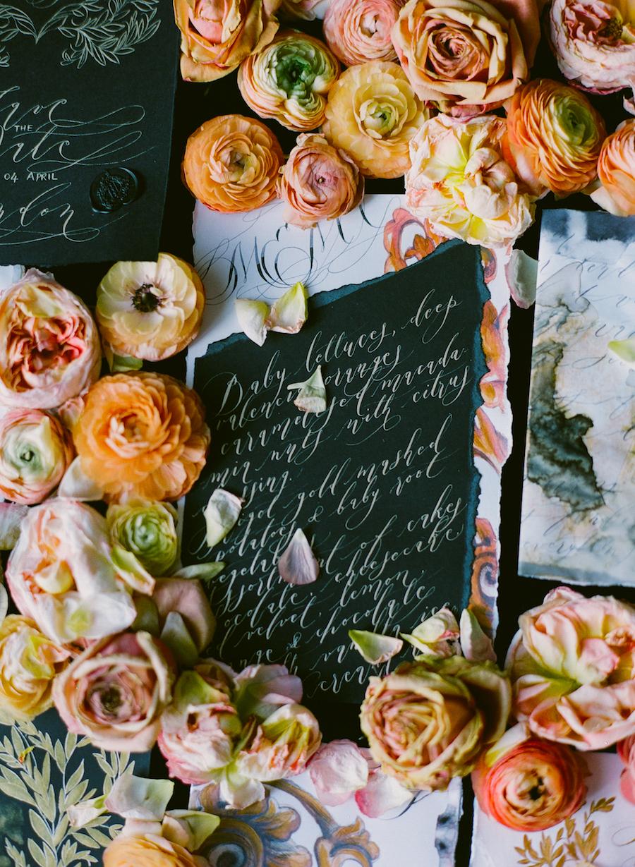 Black & gold hand painted wedding stationery LR gold menu slanted