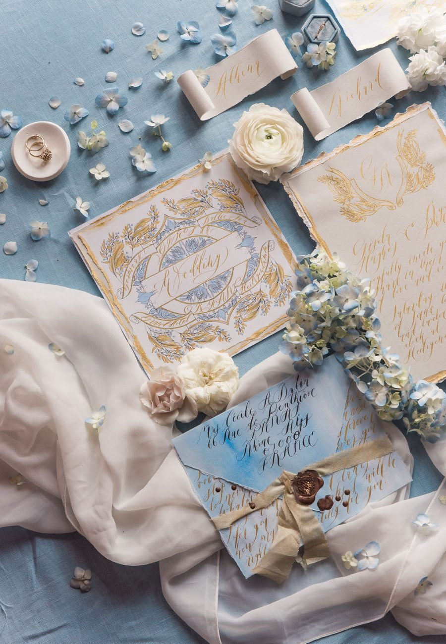 Blue and gold French style wedding stationery