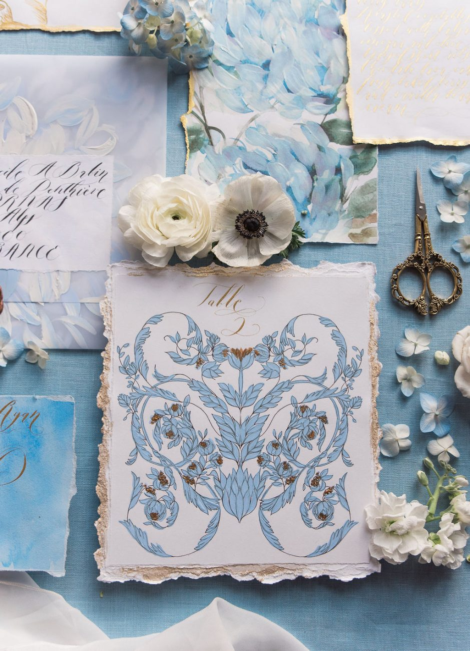 Blue and gold luxury destination wedding stationery with a table number