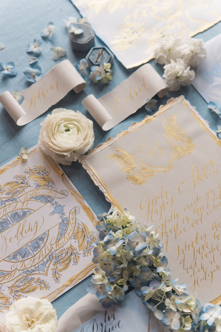 French themed country wedding invitations with hints of gold, pale blue and beige