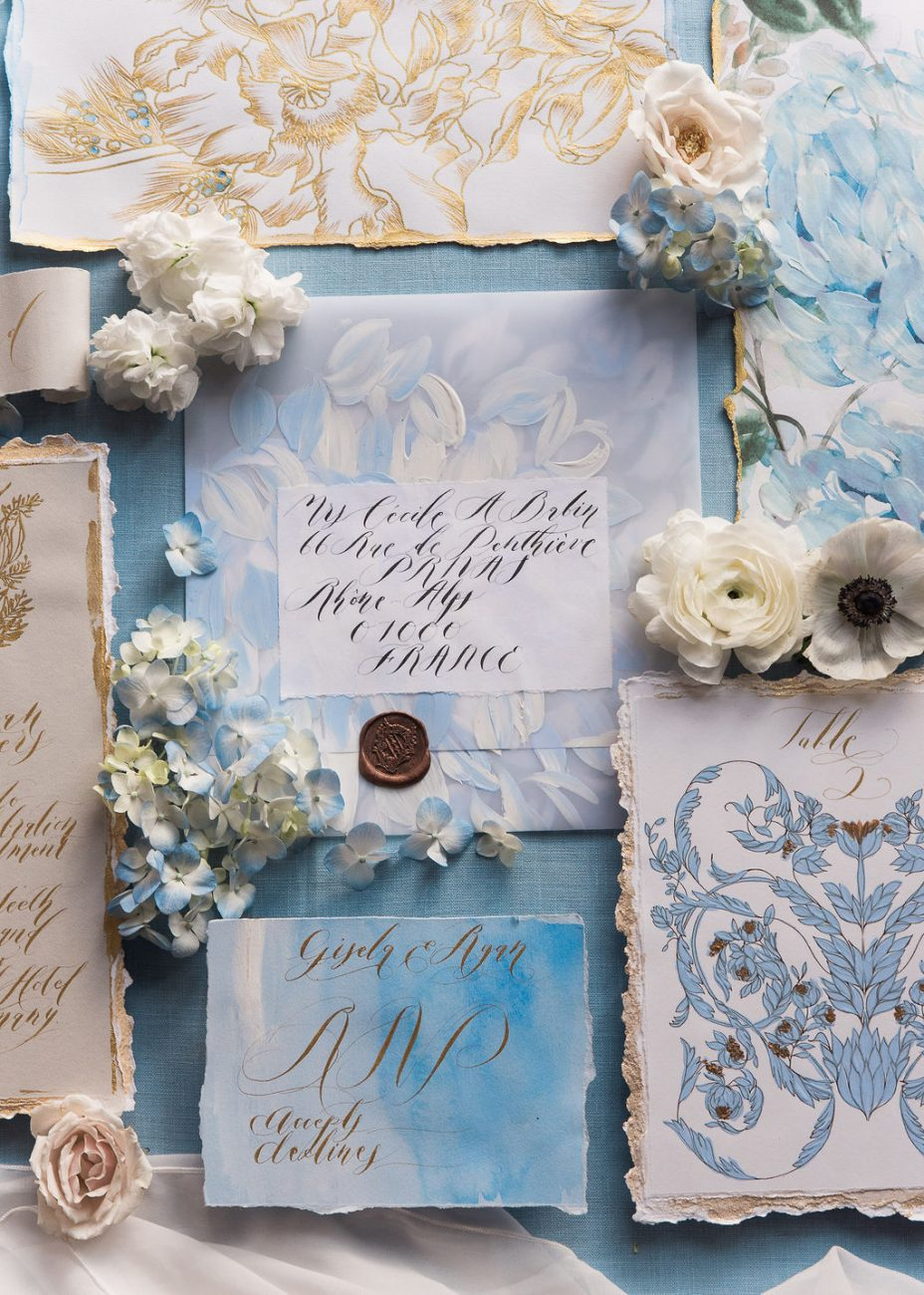 Hand painted wedding invitations with French inspired style in blue and white