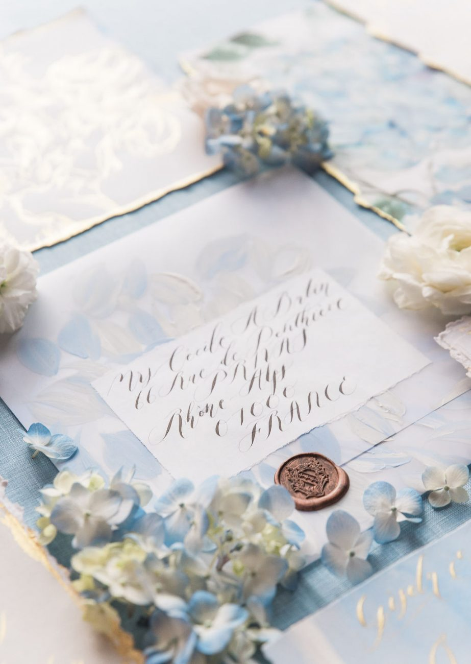 Large white vellum envelope, hand pianted with pale blue and white floral design