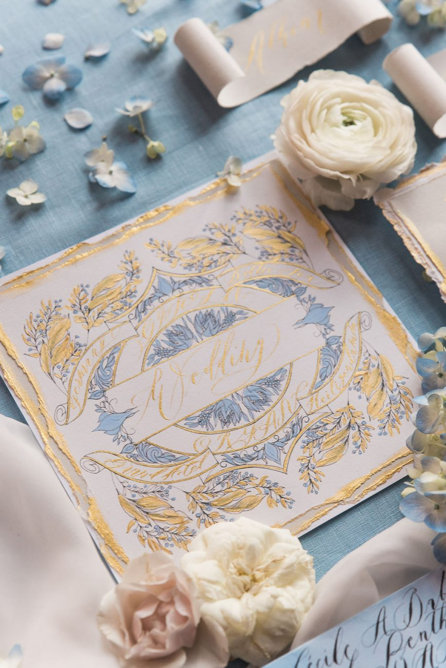 Luxury hand painted wedding invitation card with white and gold detail