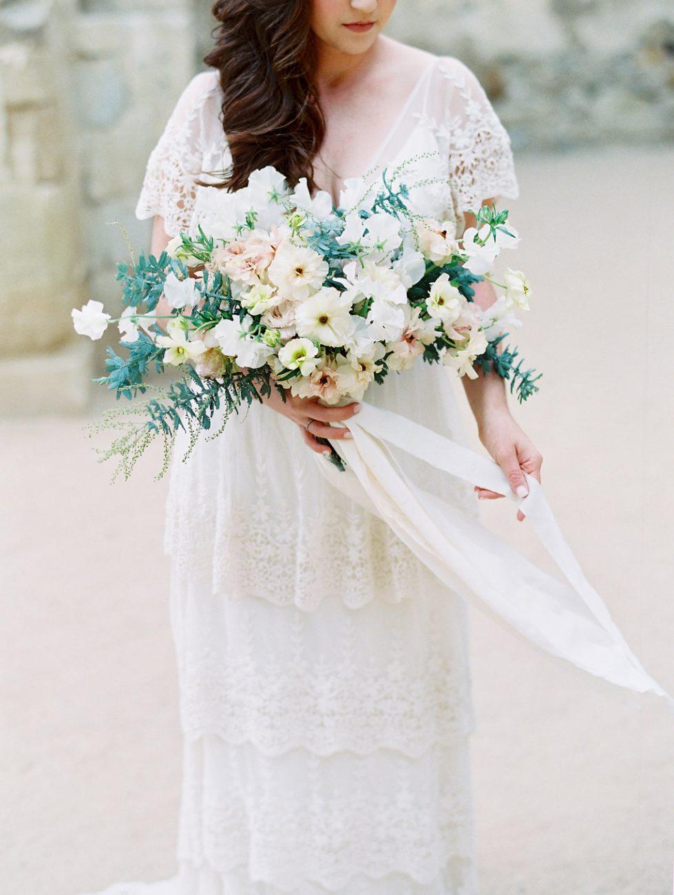 Orange Country wedding inspiration bride holding ribbons