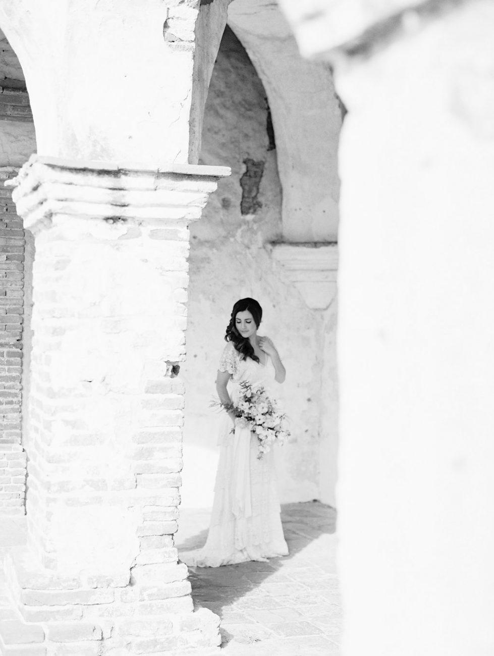 Orange Country wedding inspiration bride under arches
