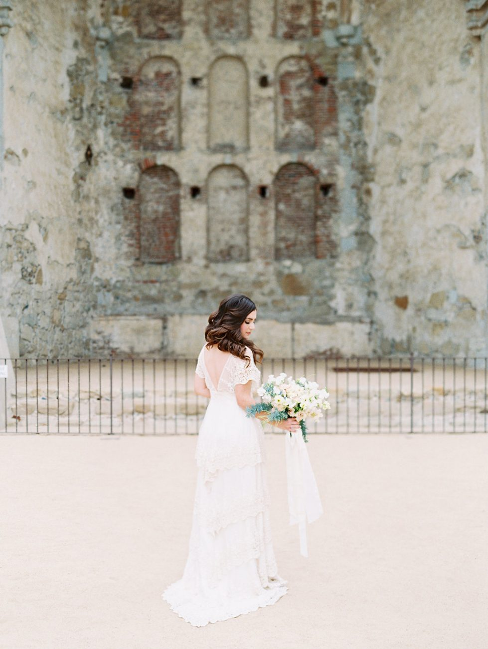 Orange Country wedding inspiration bride with flowers