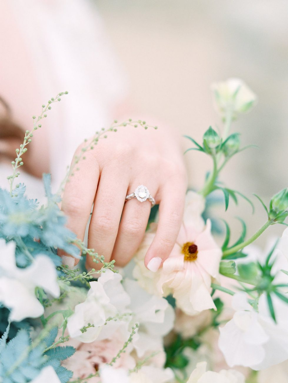 Orange Country wedding inspiration bride with ring and flowers
