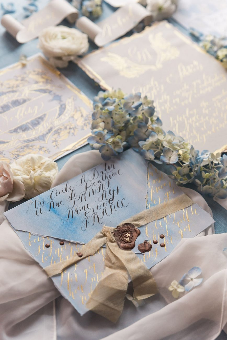 Romantically styled high end French style wedding stationery with gold details