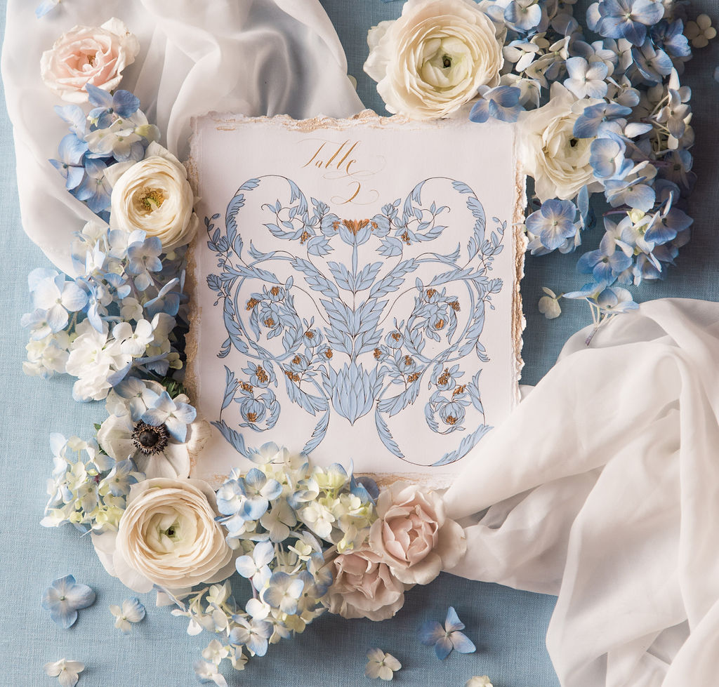 Table number with ornate design and hand painted details for a luxury destination wedding
