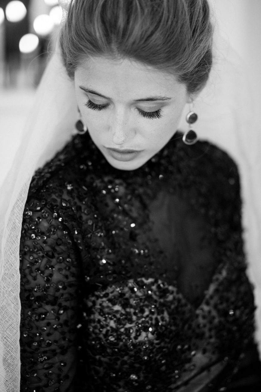 Fine Art Black Tie Wedding Inspiration Shoot Bride looking down with earrings
