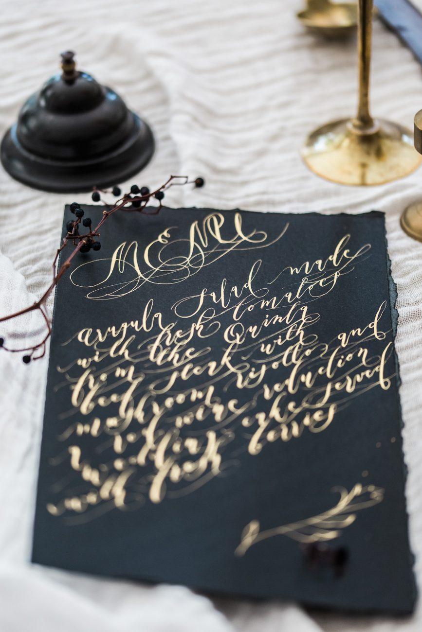 Fine Art Black Tie Wedding Inspiration Shoot black wedding menu with gold calligraphy