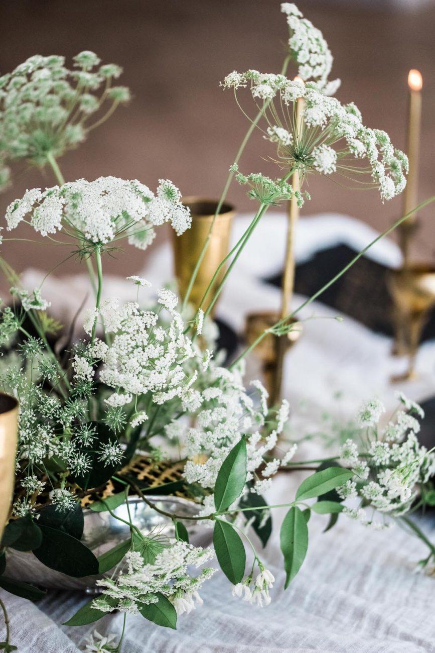 Fine Art Black Tie Wedding Inspiration Shoot green foliage with white flowers