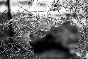 From the Depths of Darkness into the Light_ smashed window