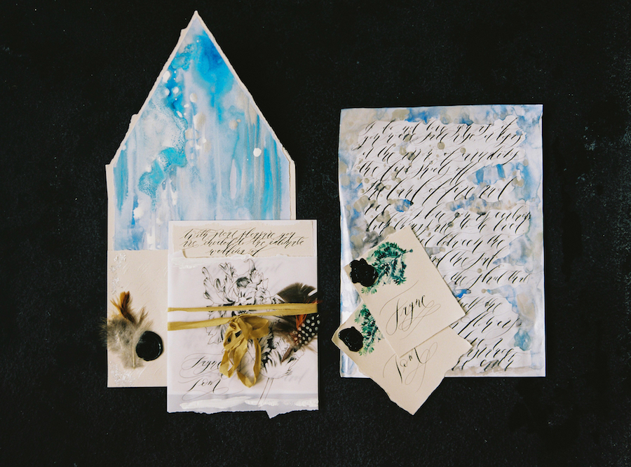 Invitation glossary with a blue and silver envelope liner copy